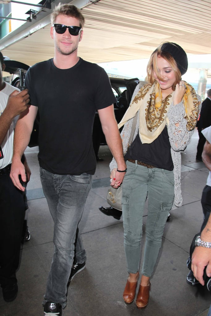 Liam Hemsworth and Miley Cyrus held hands at the airport in NYC in June 2010.