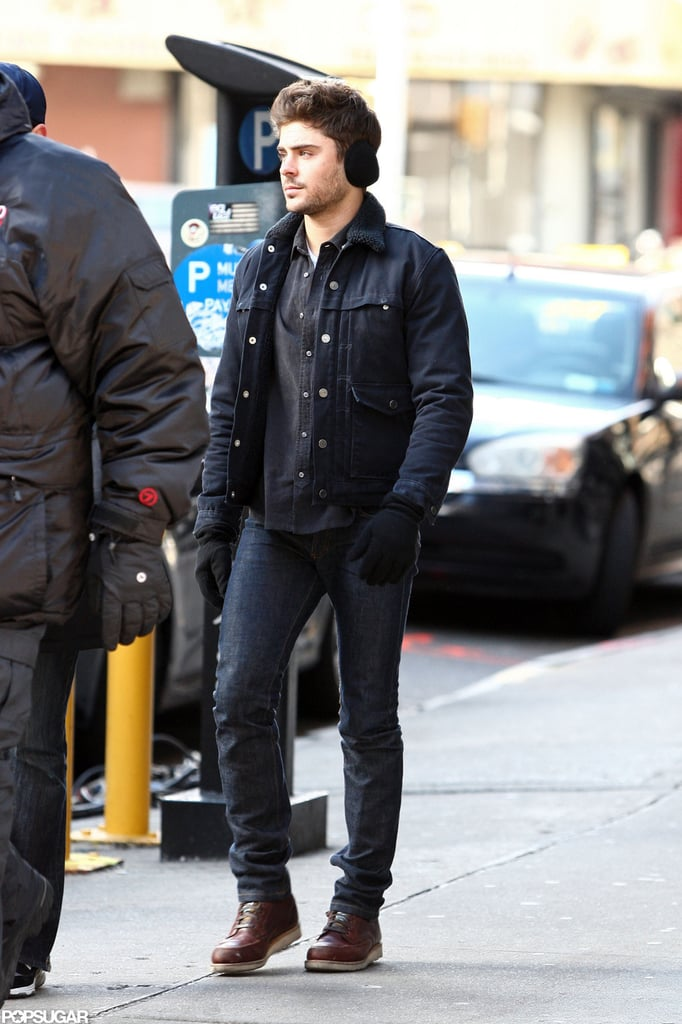 Zac Efron filmed while wearing earmuffs in NYC.