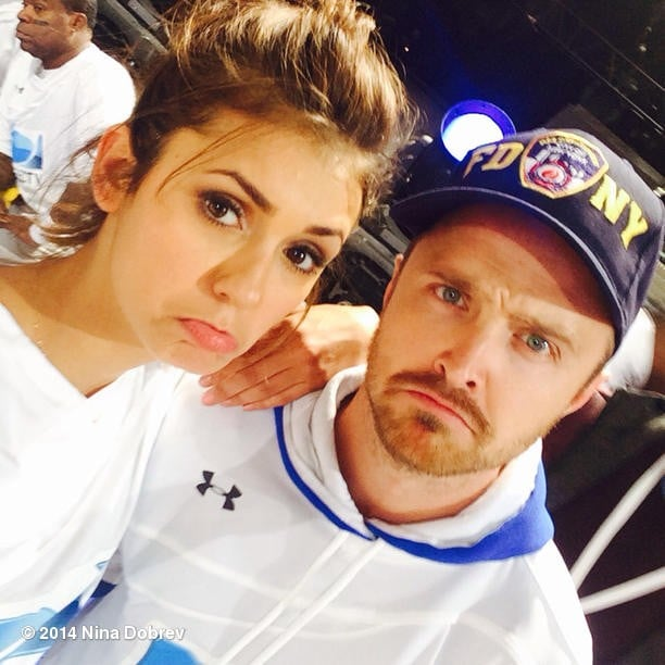 """Nina Dobrev and Aaron Paul were both bummed the Denver Broncos lost at the Super Bowl. """"We lost the game- but hey, 2nd Place is the 1st loser! @glassofwhiskey #beachbowl @direcTV"""" Source: Instagram user ninadobrev"""