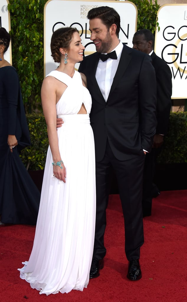 John held his wife lovingly as they both walked the red carpet at the 2015 Golden Globe Awards.