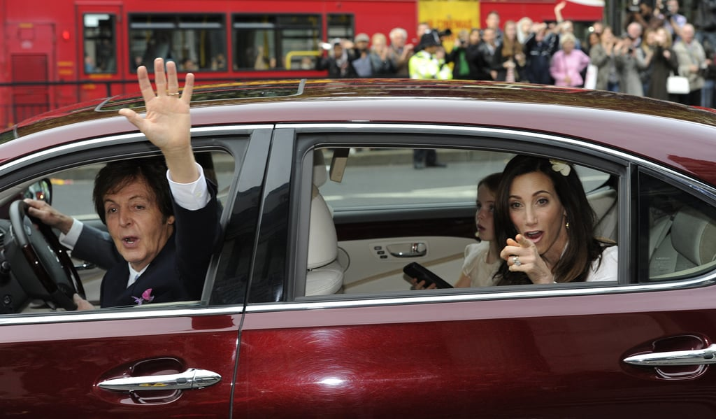 Paul McCartney waved to friends and family as he drove away with new wife Nancy Shevell.