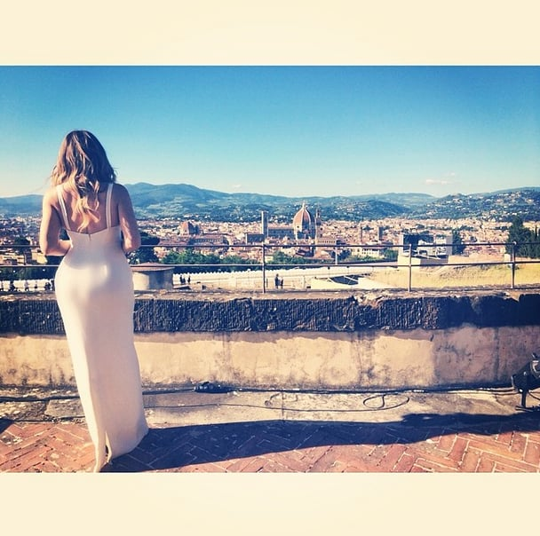 Khloe took in the view from the wedding's location while in her bridesmaid dress.  Source: Instagram user khloekardashian