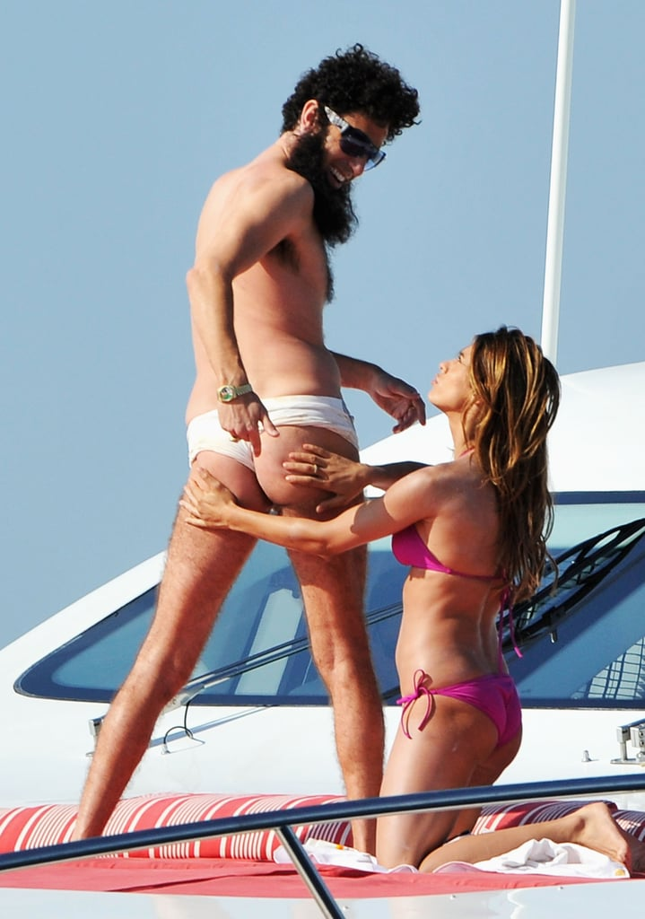 Sacha Baron Cohen and Elisabetta Canalis played around on a luxury yacht at the Cannes Film Festival.