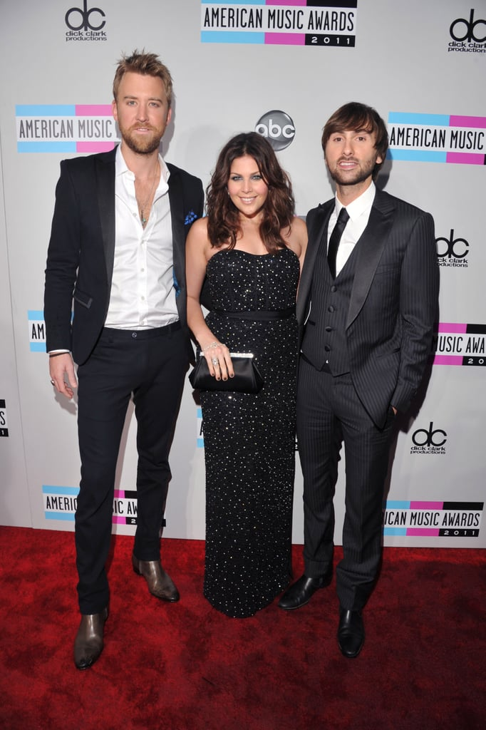Lady Antebellum's Charles Kelley, Hillary Scott and Dave Haywood hit the red carpet at the 2011 American Music Awards.