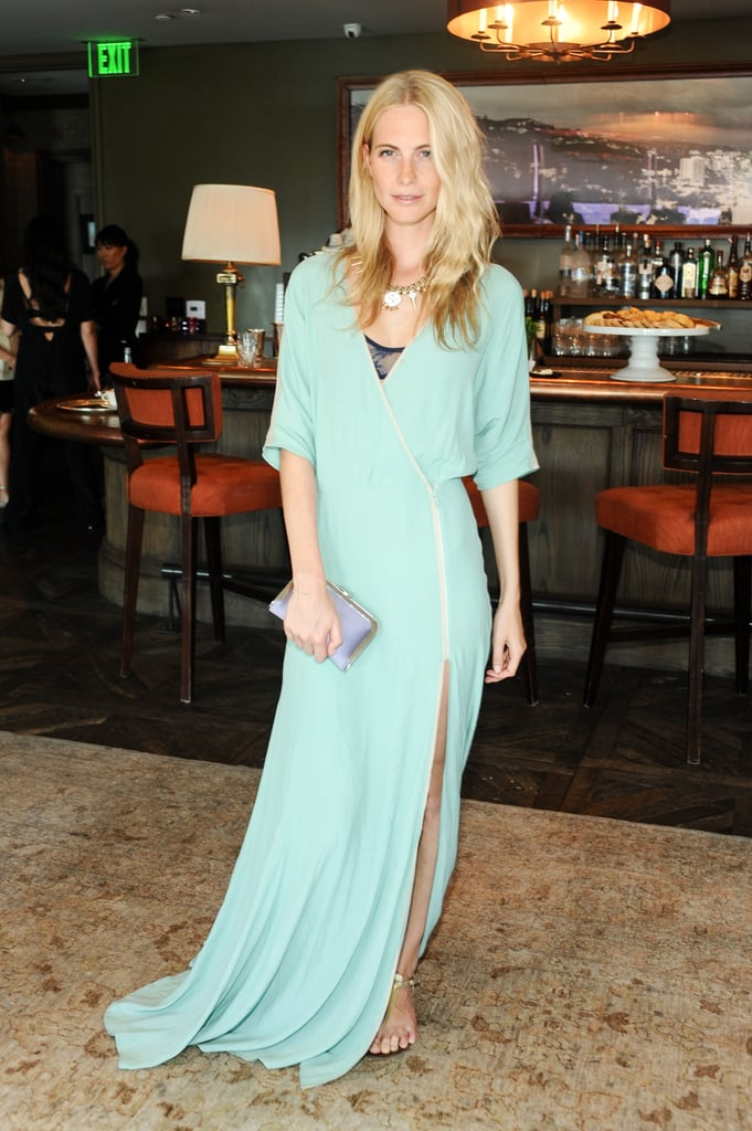 Poppy kept it elegant for a daytime luncheon in a faux wrap dress and gold chain necklace for added interest.