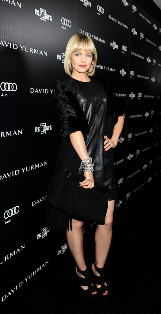 Mena Suvari takes the edgier approach to cocktail attire in cutout sandals and a moody shift.