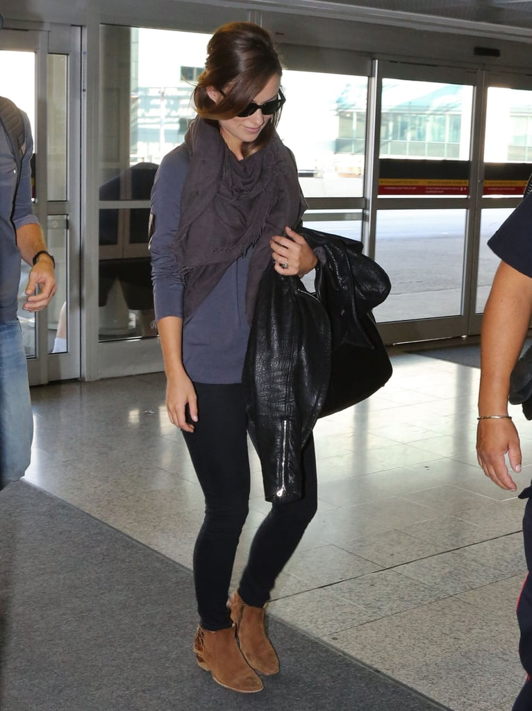Olivia Wilde was comfy — with a side of cool — in a sweatshirt, black leggings, a gray scarf, and tan booties in Toronto.