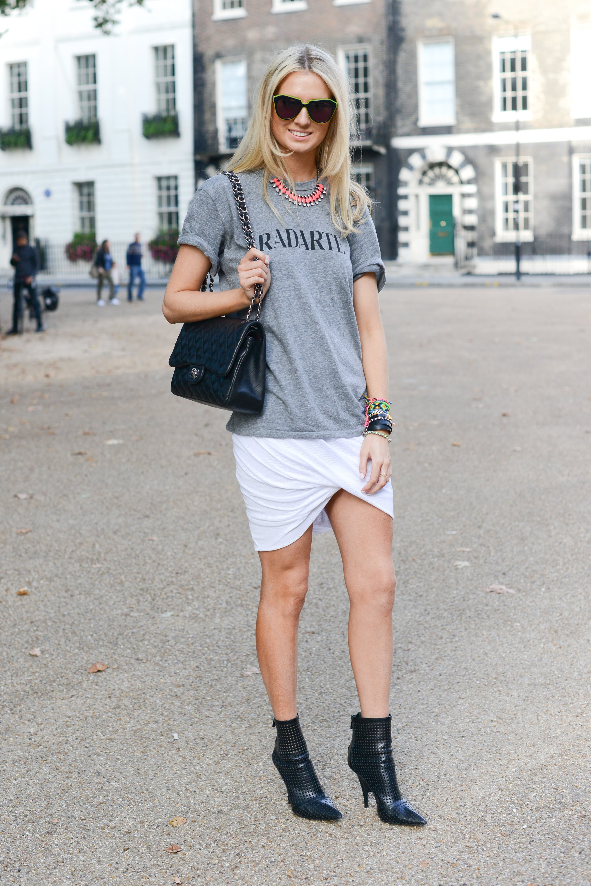 A quirky t-shirt got a dramatic skirt complement thanks to her white wrap iteration on bottom.