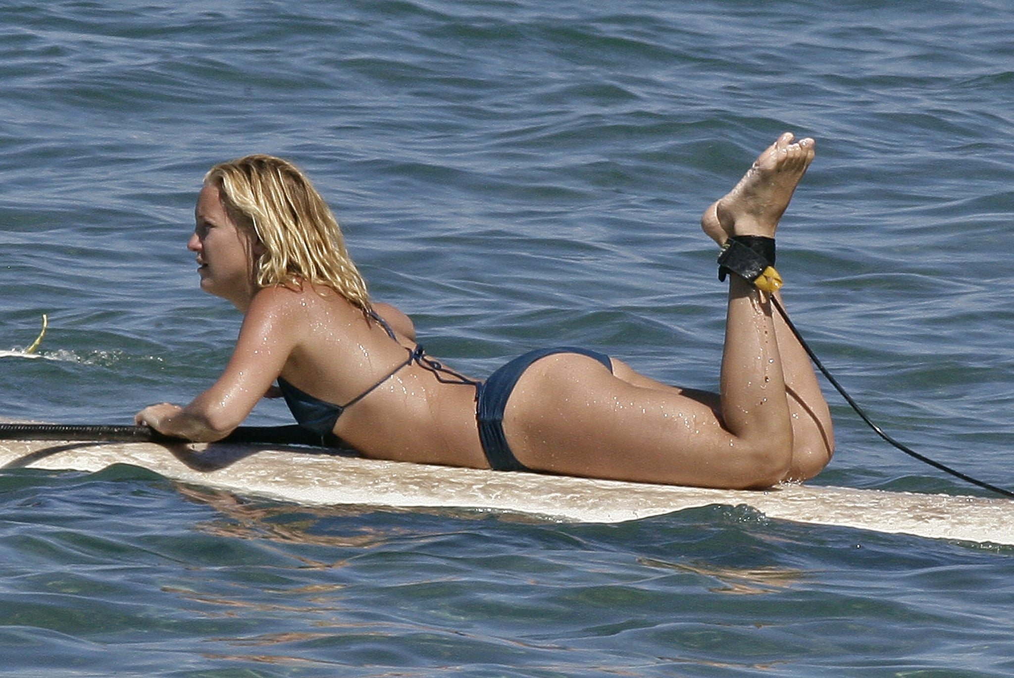 Kate hopped on a paddleboard in her bikini during a September 2006 trip to Hawaii.