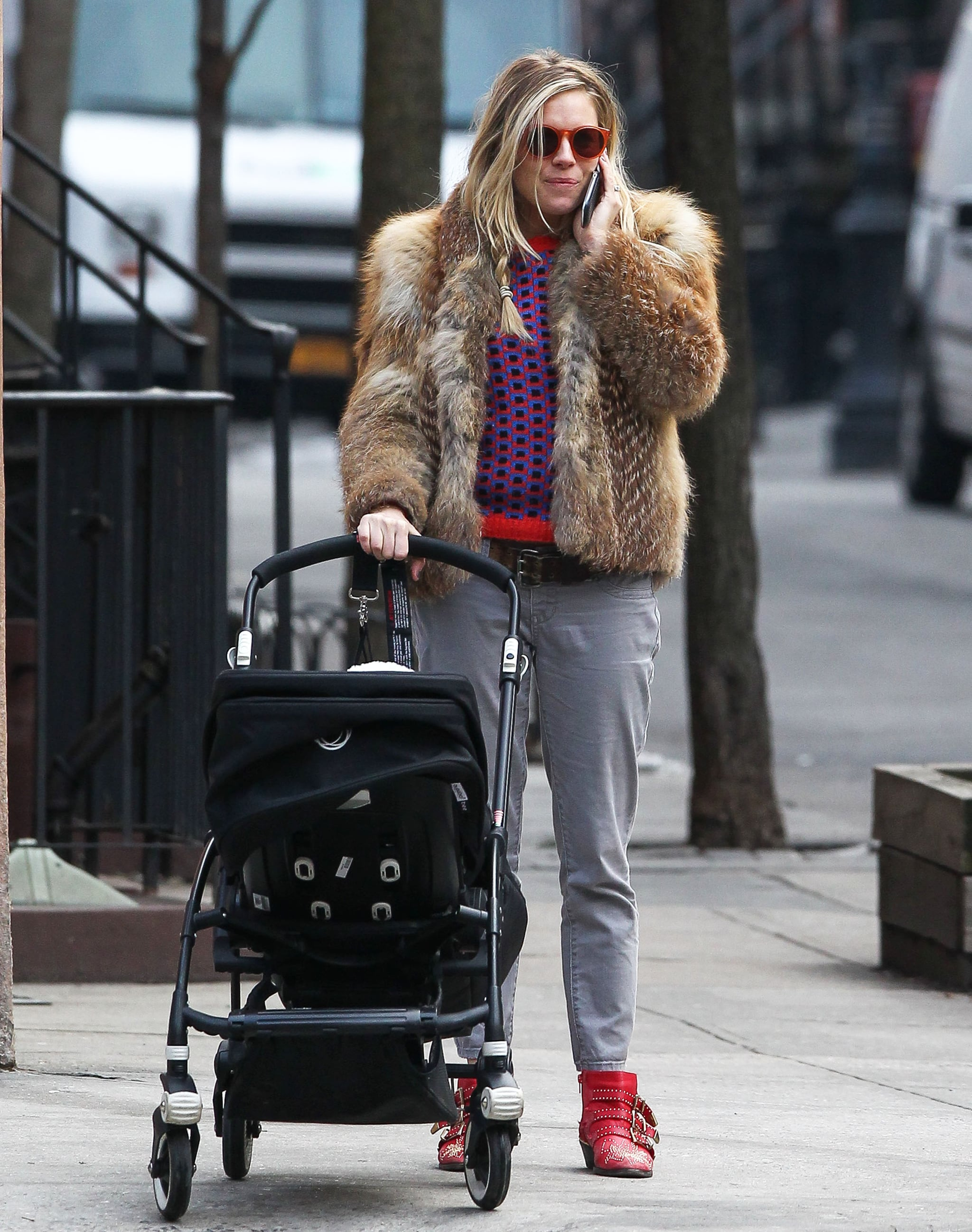Sienna Miller donned bright red shoes in NYC.