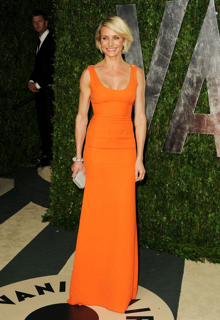 Cameron Diaz showed off toned figure in body-hugging bright orange Victoria Beckham gown.