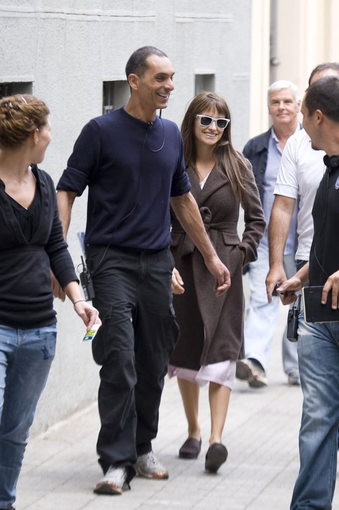 Penelope Cruz chatted with the crew heading to set.