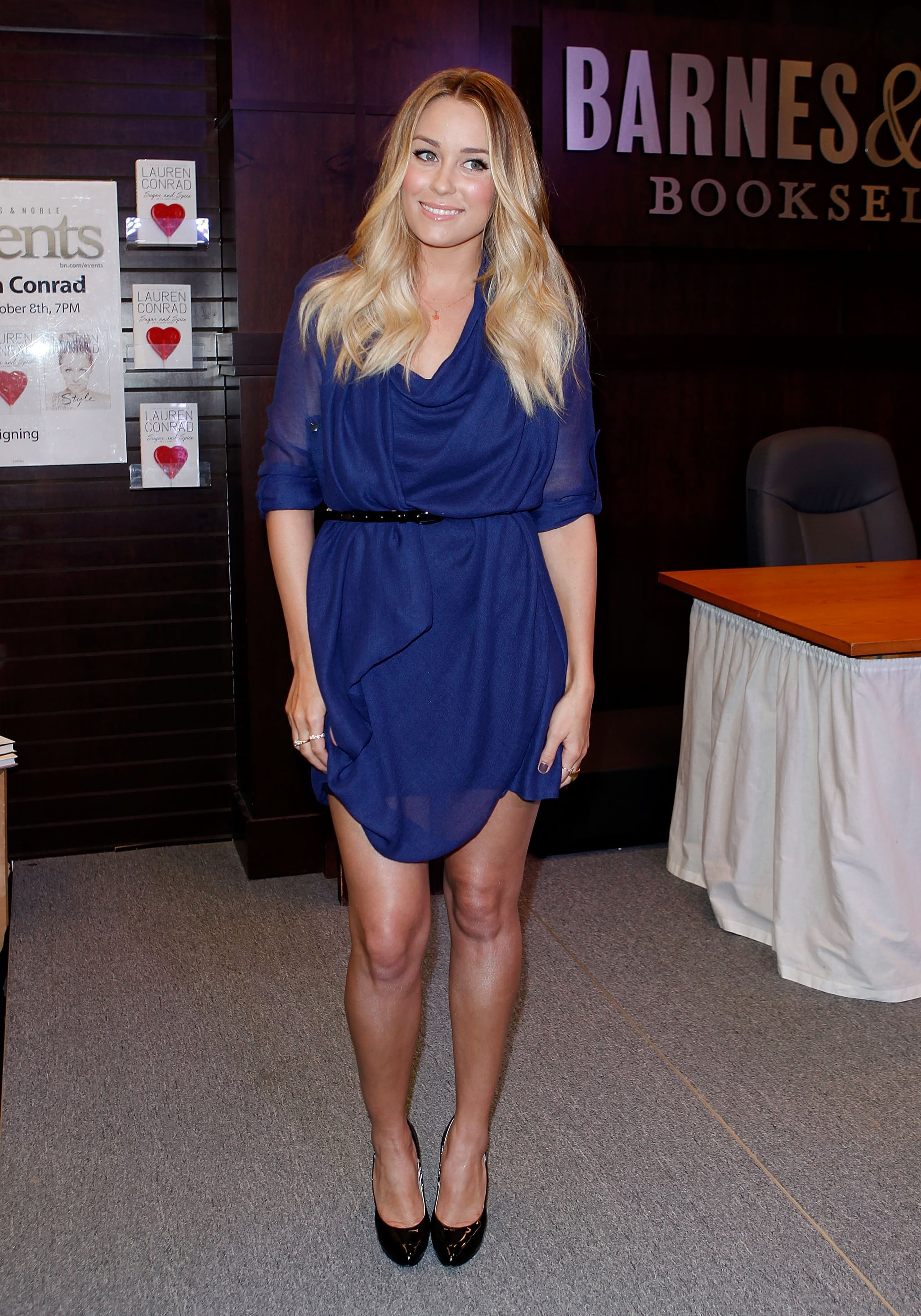 She wore a short-sleeved, draped blue BCBG Max Azria dress for a book signing in 2010. Lesson from Lauren: pairing blue with black is no longer off limits.
