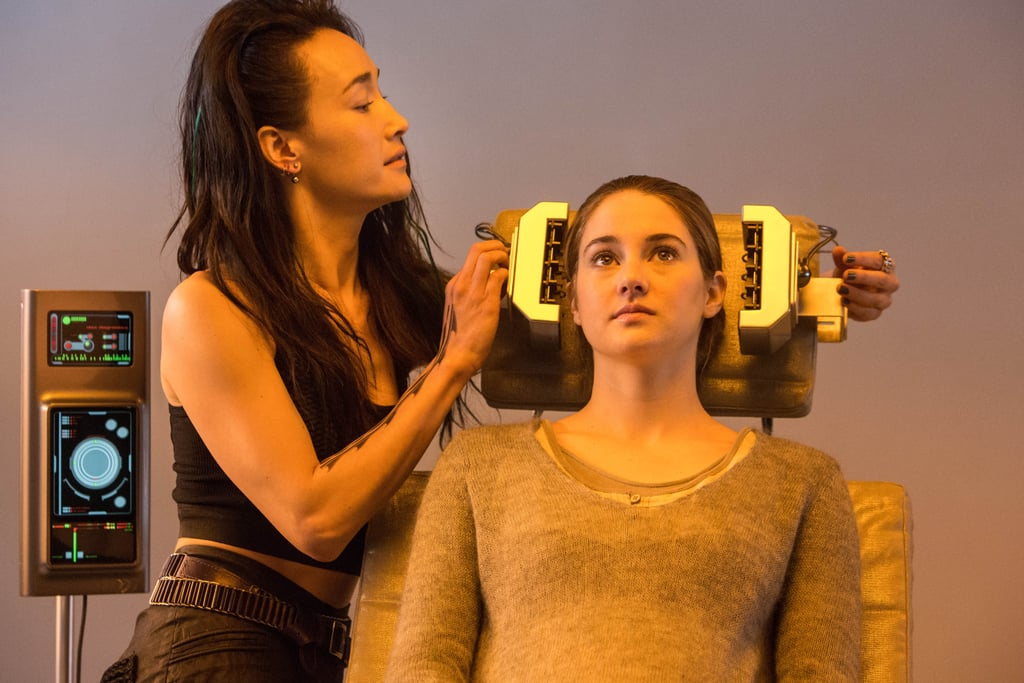 Maggie Q plays Tori, who administers a test for Tris.