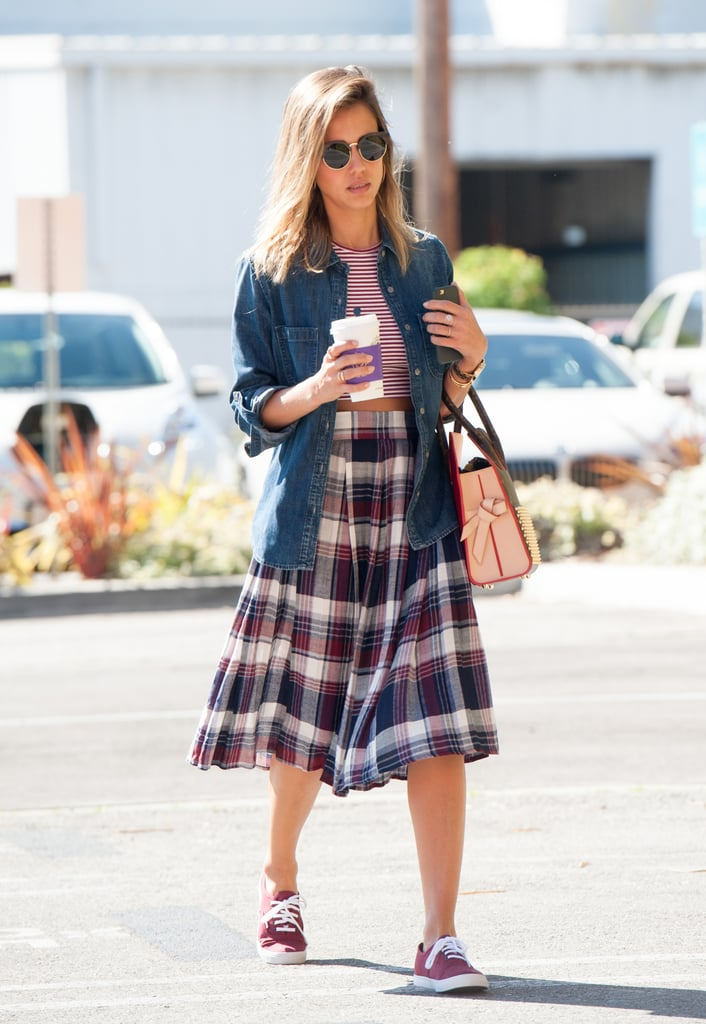 We love how Jessica layered her denim shirt over a crop top, giving her plaid skirt a schoolgirl-type twist.