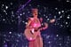 Katy Perry strummed guitar on stage.
