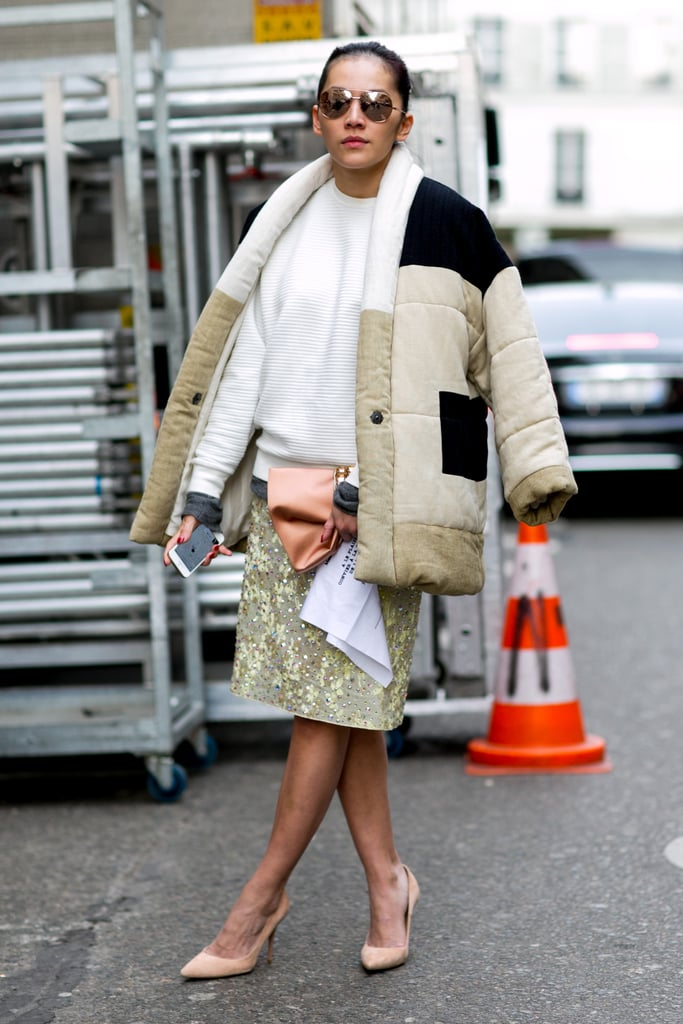 Don't reserve your puffy jackets for sportswear only; just look how well it pairs with a pretty skirt.