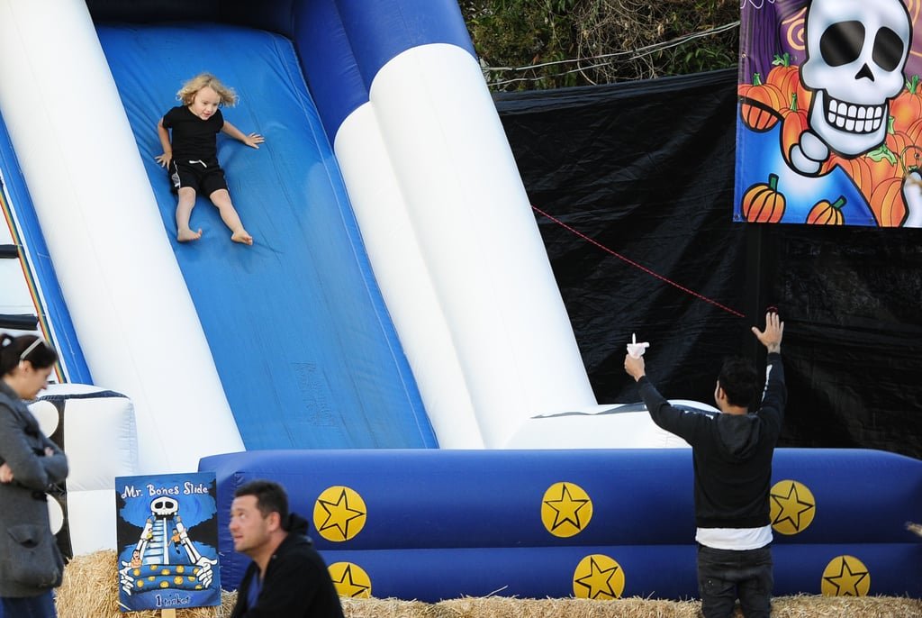 Pete Wentz watched Bronx play around on an inflatable slide.