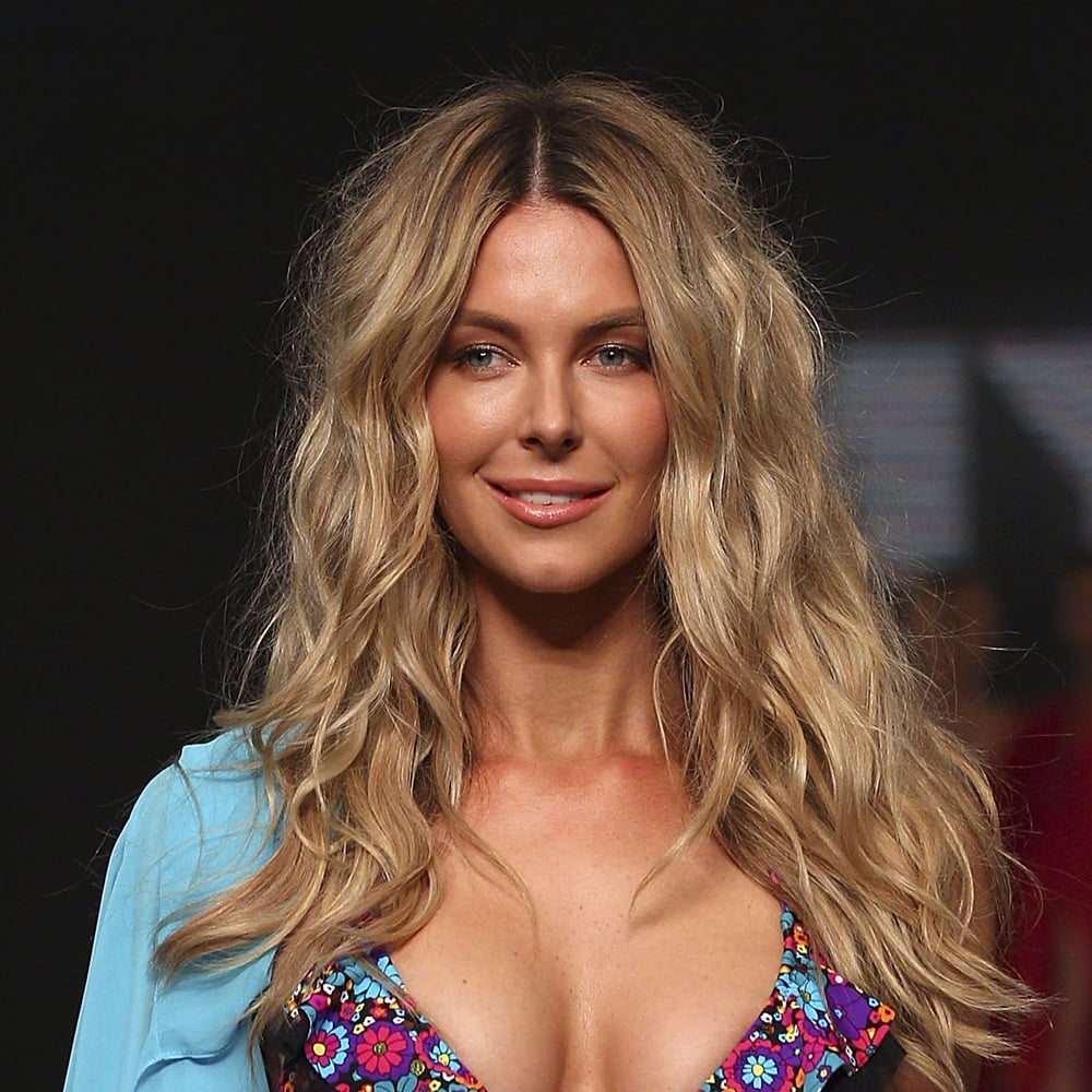 Half beachy, half bedhair, fullblown sexy. Jen's signature look is perfected on the catwalk in 2011.