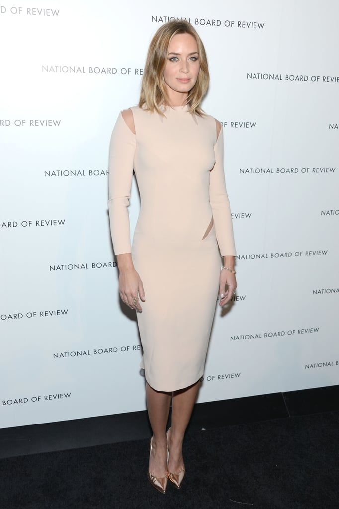 Emily Blunt embraced a minimalist silhouette and nude hue with a sexy twist via a cutout Emilio Pucci dress.