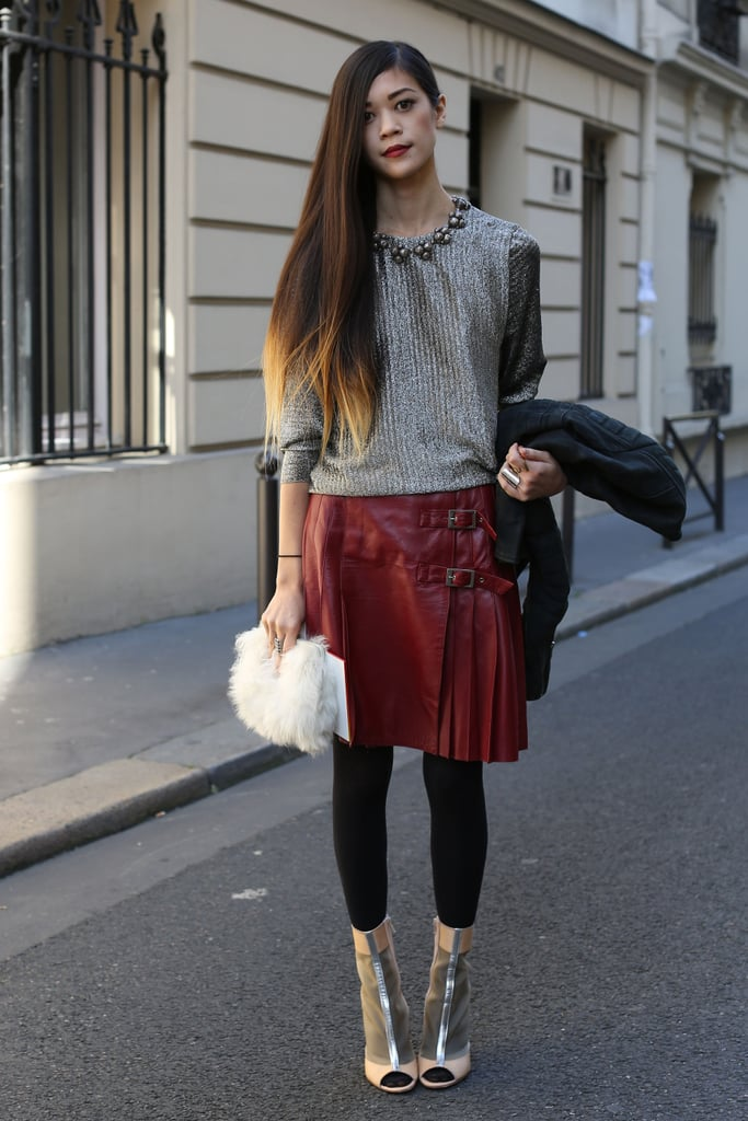 Statement pieces by the threes — this styler works a metallic top, burgundy skirt, open-toed booties, and a fur clutch with ease.