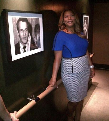 Queen Latifah posed near a photo of Paul Newman before doing some press in Canada. Source: Twitter user IAMQUEENLATIFAH