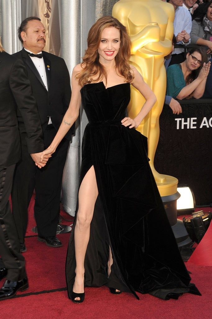 Angelina Jolie had no problem showing off the high slit detailing on her Versace Atelier gown.