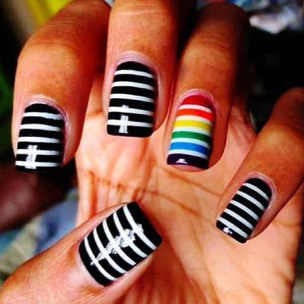 Rainbow stripes add some pizzazz to this otherwise monochromatic manicure.  Source: Instagram user deeispolished