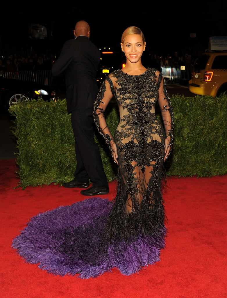 Beyoncé arrived at last year's Met Gala in a body-hugging, skin-revealing Givenchy gown. But the drama of the ensemble didn't stop there — the black-and-purple train provided an extra feathered dose of glamour.