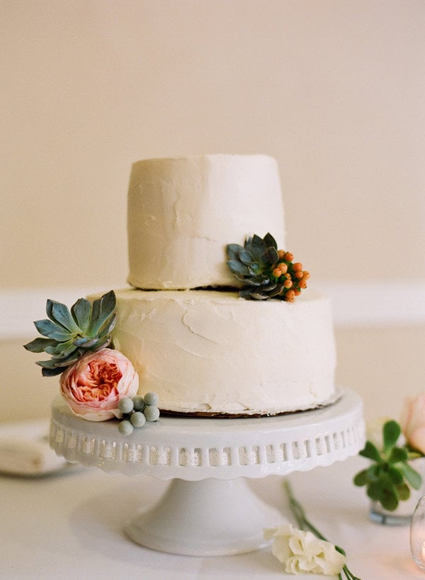 We love how succulents instantly take this simple, two-layer cake from straightforward to fabulous.  Photo by JAC Photography via Style Me Pretty