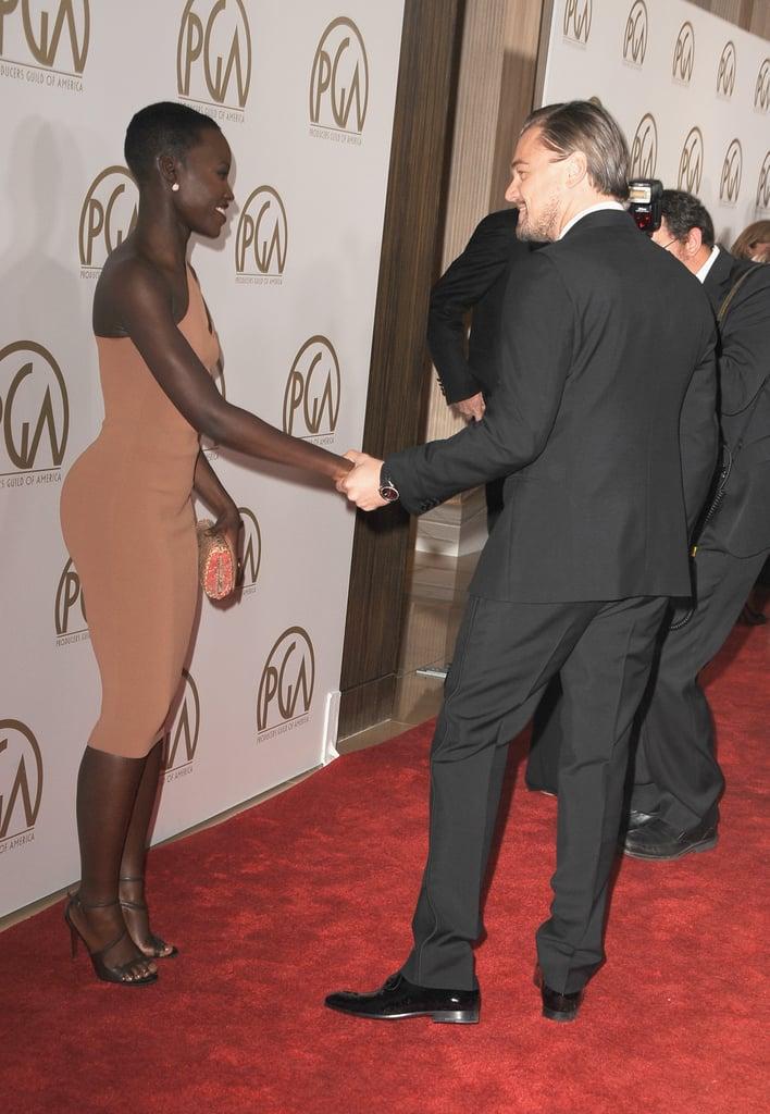 Leonardo DiCaprio held Lupita Nyong'o's hand when they spoke.