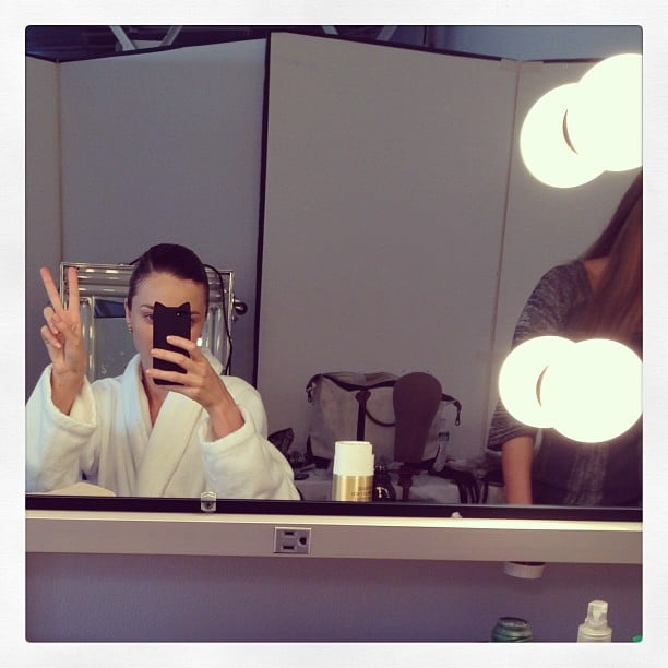 Miranda Kerr flashed a peace sign as she sat in the hair-and-makeup chair. Source: Instagram user mirandakerr