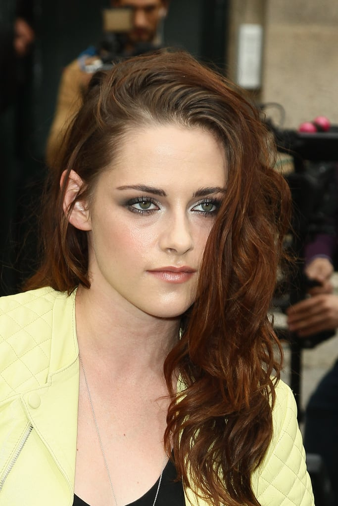 Kristen Stewart posed for photographs on her way into Balenciaga's show in Paris.