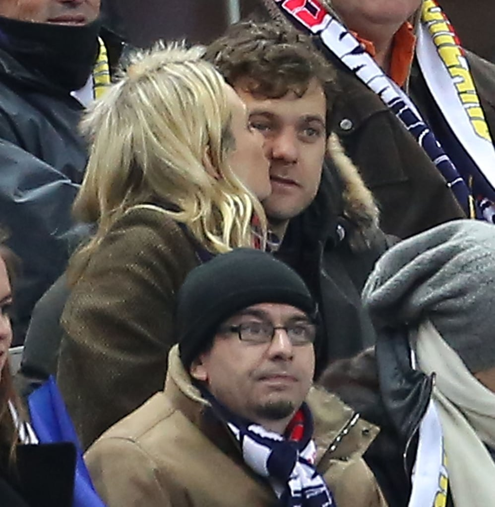 Josh and Diane Cuddle and Kiss in the Paris Soccer Stands
