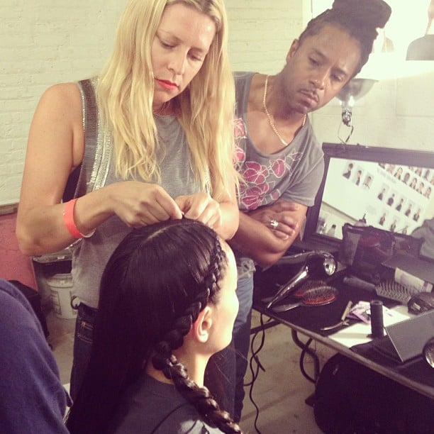 Lead hairstylist Esther Langham took a moment to give her team a braiding tutorial before the Kenneth Cole show.