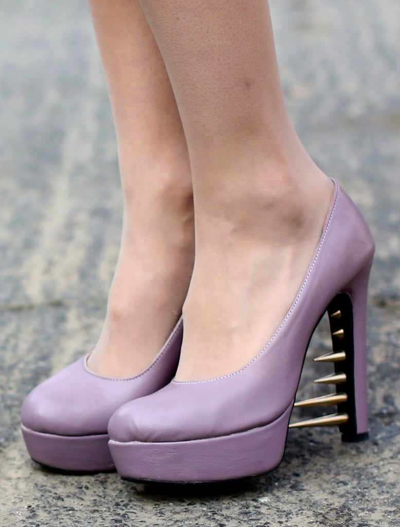 Ladylike lavender pumps were updated with subversive spikes — ouch.