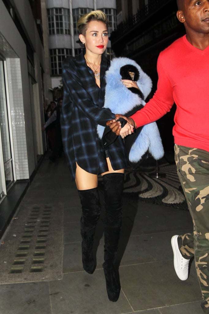 While out in London on Sept. 10, Miley wore an oversized plaid top and thigh-high boots.