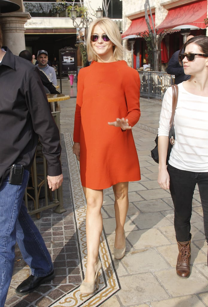 On her way to an interview with Extra at The Grove in LA, Julianne Hough looked fabulously mod in an orange Alberta Ferretti square-neck dress and nude suede Yves Saint Laurent pumps. We love her on-trend mirrored shades, too.