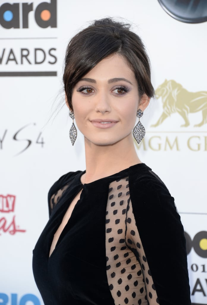 Gray eye shadow and a pinkish, nude lip on Emmy Rossum are an elegant choice for the modern bride.