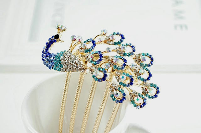 """A nontraditional bride should go for something playful like a peacock hair comb ($25), which could also serve as your """"something blue."""""""