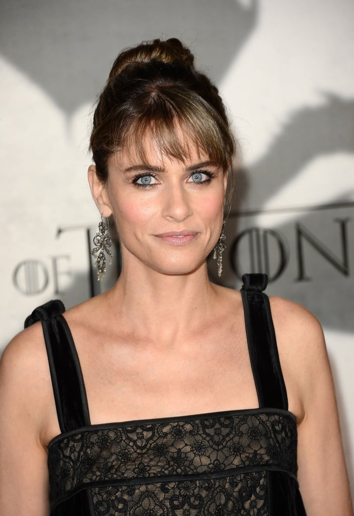 From her polished updo to her wispy bangs and black dress, Amanda Peet seemed to be channeling her inner Holly Golightly at the Game of Thrones season premiere. With a look this classic, she nailed the naturally flattering makeup look with pink blush, soft eyeliner, and lush lashes.