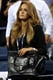 Kim Sears showed off her black Ted Baker bag while taking in the US Open in New York.