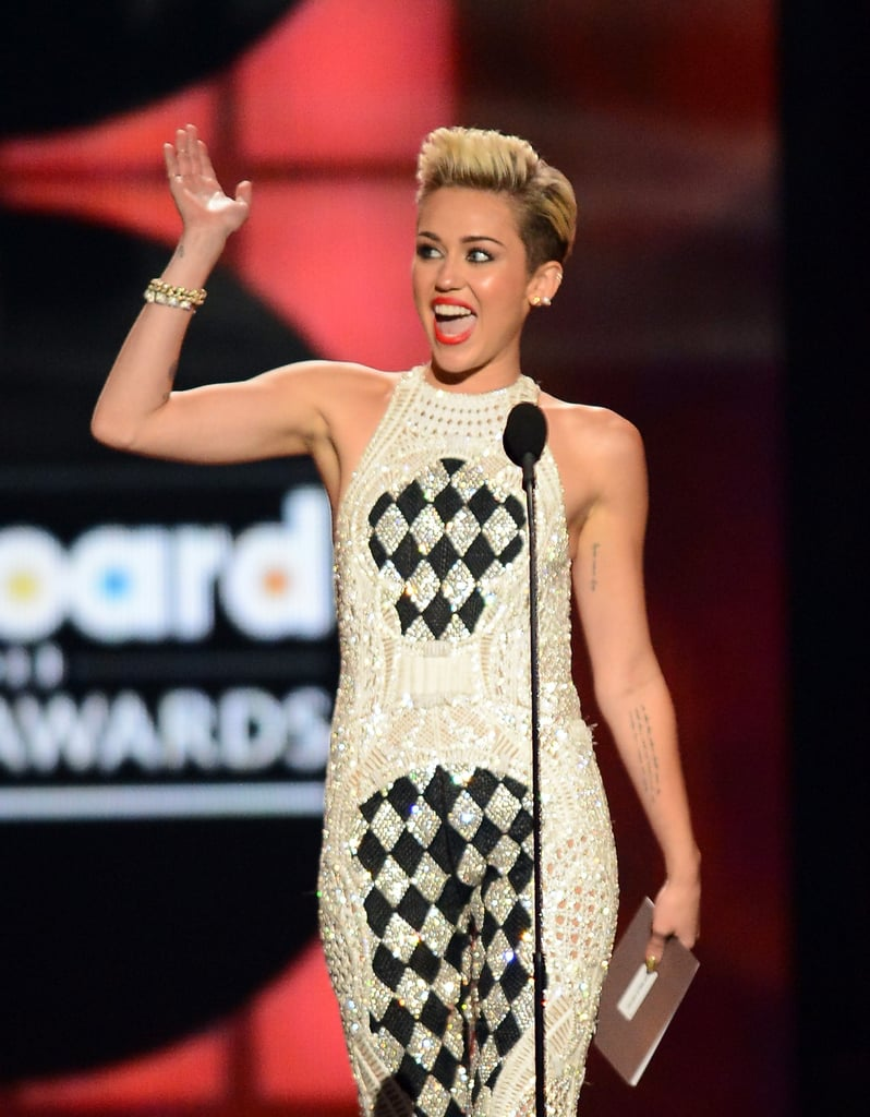 Miley Cyrus waved to fans when she presented an award.