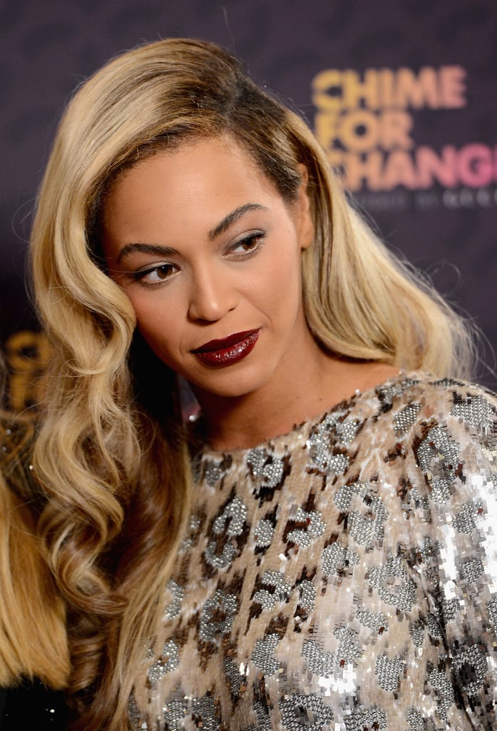 The hostess for the night, Beyoncé Knowles wore a dark plum lipstick, and her bright blond locks were styled in a vintage-style one-sided hairdo.
