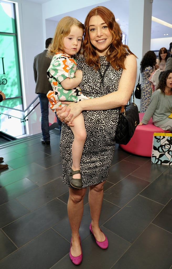 An expectant Alyson Hannigan brought lil Satyana, 2, to the event.