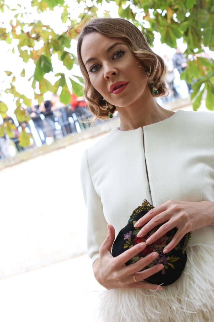 An embroidered clutch lent a pretty finish to high-fashion feathers.
