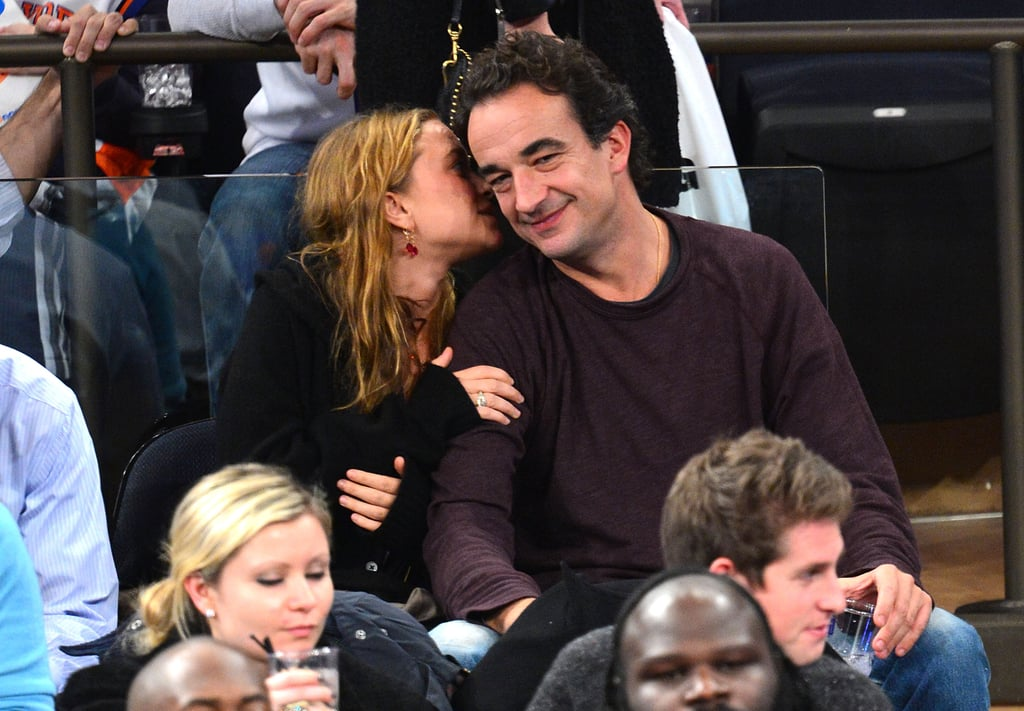 Mary-Kate Olsen whispered to boyfriend Olivier Sarkozy.