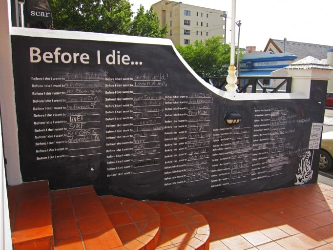 """This wall in Cape Town, South Africa, created in 2012, featured aspirations from """"meet Mr. Mandela"""" to """"grow old."""" Photo courtesy of BeforeIDie.com"""