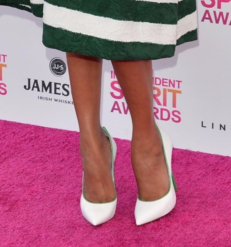 Zoe Saldana matched her green-and-white striped Dolce & Gabbana dress with white-and-green Casadei pumps at the Spirit Awards.