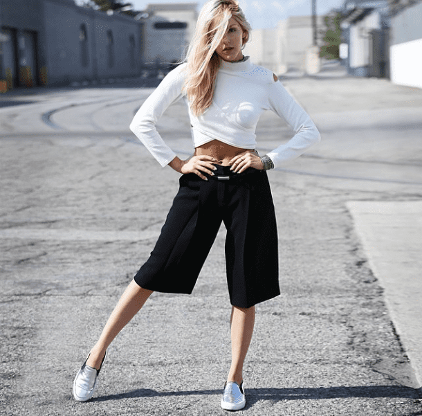 Take the plunge with a midriff-baring knit, then counter it with culottes and a pair of slip-on kicks. Source: Instagram user peaceloveshea